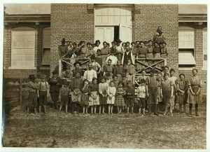 Employees at the Tifton mill. The front row comprises children (including several of the Young family), many of whom were illegally employed. Catherine Young is on the back row. Credit: photo by Lewis Hine, Library of Congress