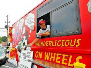 Wendy Cross dishing out arepas from Wow! Food Truck (Credit: Wow! Food Truck)