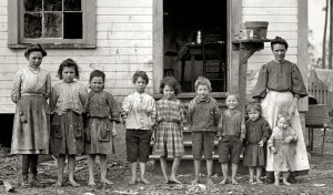 Nine of eleven children of Catherine Young (right). She, along with the six oldest children in this picture, worked in the Tifton Cotton Mill (1909). Credit: Photo by Lewis Hine. Library of Congress