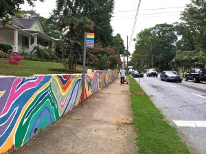 Civic pride is evident along some streets near Turner Field, including this wall facing Hank Aaron Drive, in a photo taken in July. Credit: Donita Pendered