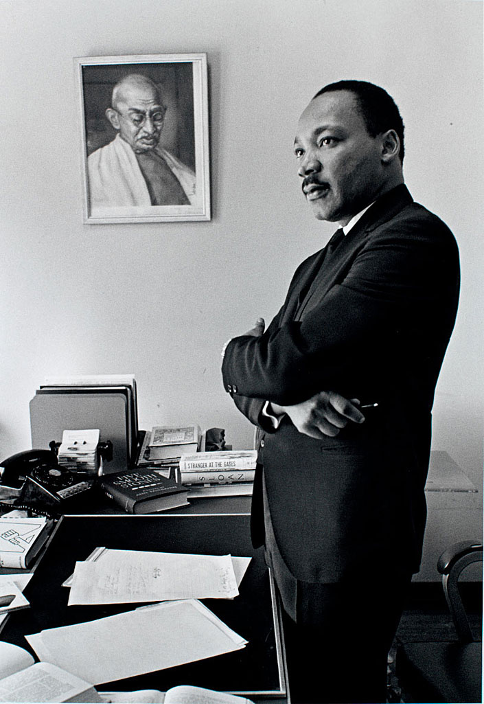 Martin Luther King Jr. with framed portrait of Gandhi. Credit: Photo by Bob Fitch