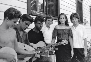 Greg Wittkamper (left, with his brother Billy) tries out a banjo for friends in 1962. Credit: PublicAffairs Books.