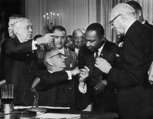 President Lyndon B. Johnson, signing the Voting Rights Act of 1965 into law, with Martin Luther King Jr. Credit: Library of Congress