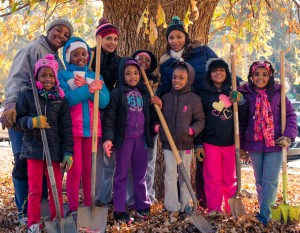 As they are to participate in a tree planting event Friday at Milford Elementary School, in Cobb County, Bank of America volunteers helped students from Columbia Elementary School, in Decatur, plant trees in November.