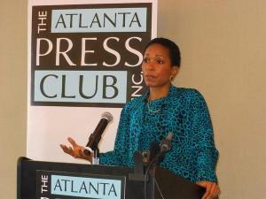 CARE CEO Helen Gayle speaks to Atlanta Press Club members in 2013. Credit Denis O'Hayer / WABE