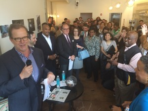 Architect Michael Gamble addresses crowd gathered in Condesa Coffee at Atlanta Daily World