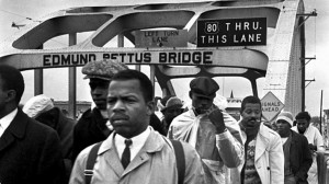 John Lewis at the Edmund Pettus Bridge during a march now being commemorated. Credit: imgkid.com