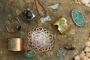 Collision glass is repurposed as pins, belt buckles, rings, and more, sold for $12 to $30.