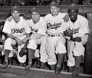 Pictured April 15, 1947, Jackie Robinson and his Brooklyn Dodgers teammates (from left): John Jorgensen, Pee Wee Reese, and Ed Stanky. Credit: Associated Press