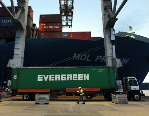 Cranes lift containers off ships and set them on trailers which will take them to a holding area. File/Credit: GPA