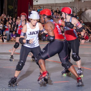 Queen Loseyateefa (aka Maisha Polite) blocks an opponent. (Credit O-Jen Ishii)