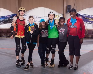 """Atlanta Rollergirls moms and their roller derby daughters (from left): Michelle """"Hate Ashbury"""" Brattain and daughter Tui (aka """"Cat-a-Gory""""); Shannon """"Deathskull"""" Nowlan and daughter Elie (Electric Penguin); Maisha """"Queen Loseyateefa"""" Polite and Madison. (Photo credit: O-Jen Ishii)"""