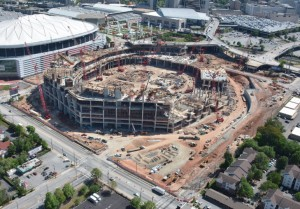 Construction cranes inside and around the stadium facilitate the pouring of concrete. Credit: newstadium.atlantafalcons.com