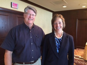 Mary Laschinger  standing next to John McCarty, a shareholder at Veritiv's annual meeting