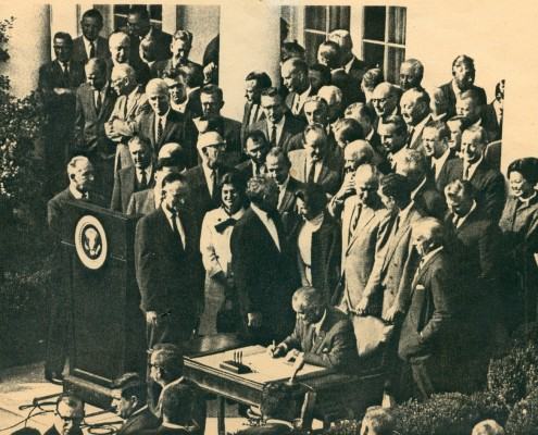 President Lyndon Johnson signing the legislation that created NEH and NEA, in 1965
