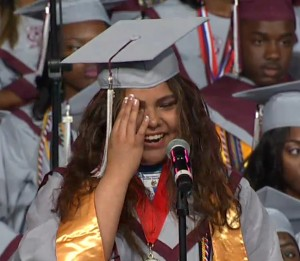 Photo of an emotional Vanessa Badillo-Rodriguez speaking Friday as valedictorian of Carver School of the Arts.