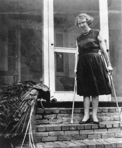 Flannery O'Connor and peafowl at her family farm, Andalusia, in Milledgeville. Credit: Photo by Joe McTyre / AJC