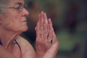 Sue TeStrake of Atlanta, 72, in eagle pose at Still Hot Yoga in Decatur.