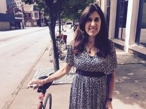 Mia Birk of Alta next to bicycles parked on sidewalk (Photo: Maria Saporta)