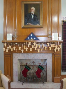 Over the mantel hangs a portrait of Andrew Carnegie, presented by Mrs. Louise Carnegie at the refurbishing of the library in the 1940s.