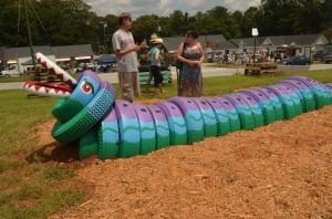Boulder Beast, a tire dragon, is named after the adjacent Bouldercrest Drive. Credit: East Atlanta, drill drain holes