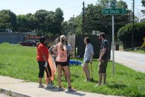 On Day 1 of the East Atlanta Corner Project, volunteers discuss the work required to turn a vacant lot into a community gathering place. Credit: Sylvia McAfee