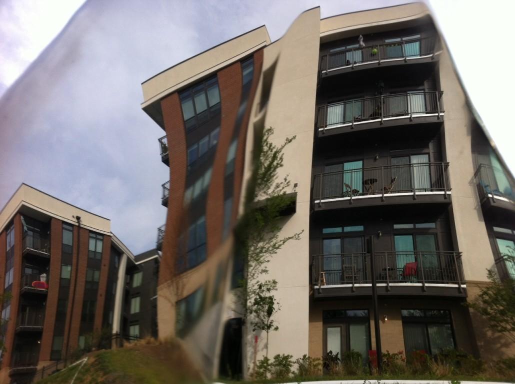 Crazy Rental Market by Kelly Jordan. Reflection in artwork - backside of mirrored leaves along Beltline.