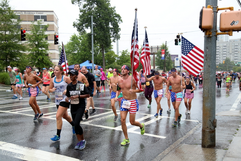 God Bless America! These guys with the flags where running up Cardiac hill during the Peachtree Road Race by Kemet Alston