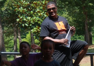 HOPE Atlanta counselor with children getting assistance at 2015 Back to School program (Special: HOPE Atlanta)