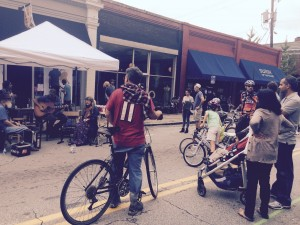 People attending Atlanta Streets Alive stop to listen to a band playing along North Highland