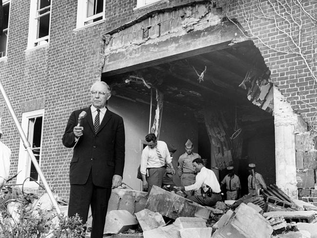 """Atlanta mayor William B. Hartsfield stands beside damage from a bomb at the Hebrew Benevolent Congregation, or """"the Temple,"""" on October 13, 1958. Credit: Atlanta Journal-Constitution"""