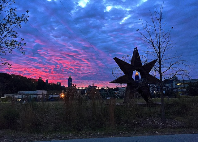 Cloudy But Colorful Sunset Over Midtown with the Bank of America Building Seen Through the Lens of 247 Timestar (metal sculpture created by Charlie Blackcap Smith for Art on the Atlanta BeltLine):