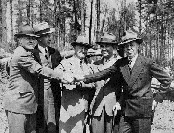 (L-R) Frank Shaw of Atlanta Chamber of Commerce, Cobb County commissioner George McMillan, Atlanta Chamber representative Ivan Allen Sr., county attorney James V. Carmichael, and Marietta mayor Rip Blair at the groundbreaking of Bell Bomber on April 2, 1942. Photo: Georgia Archives, Vanishing Georgia Collection