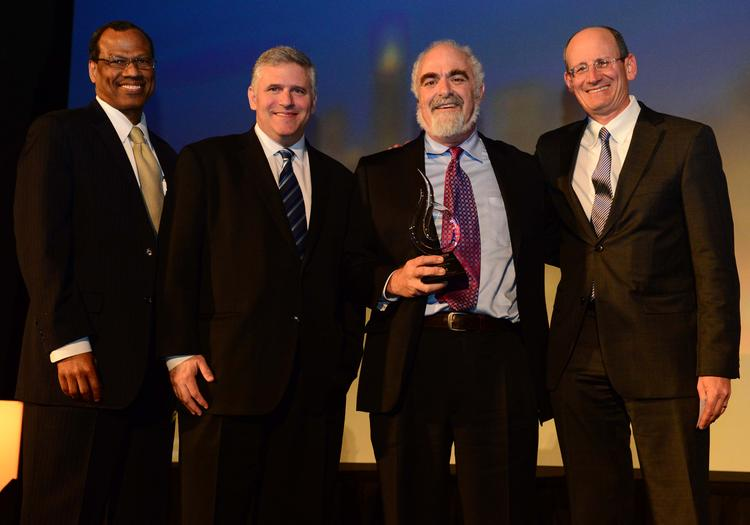Egbert Perry, Phil Kent, Cliff Kuhn, and A. J. Robinson in 2013. Kuhn received the Turner Downtown Community Leadership Award, given by Central Atlanta Progress. Photo: Atlanta Business Chronicle