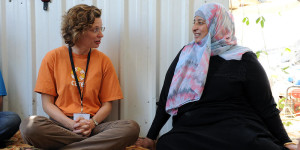 Michelle Nunn, CEO of CARE USA, with Nisreen, a community representative in Asraq Refugee Camp in Jordan. MARY KATE MACISAAC / CARE
