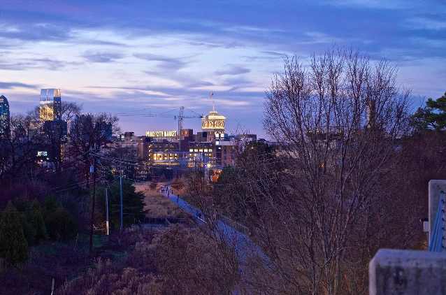 Early evening shot of an illuminated Ponce City Market with BeltLine Eastside Trail in foreground by John Becker