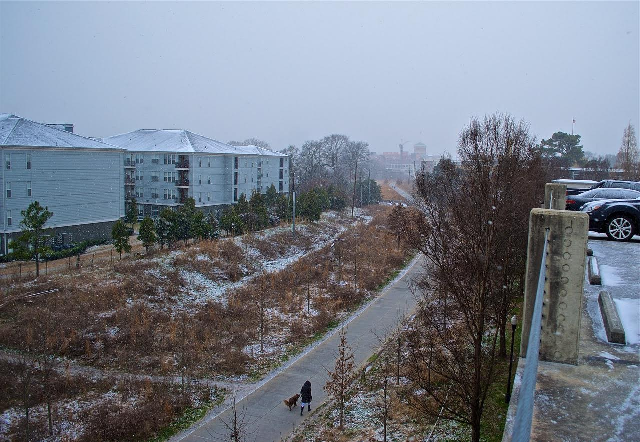 Snow falling on the BeltLine Eastside trail taken from the top of the Freedom Heights condos parking deck.