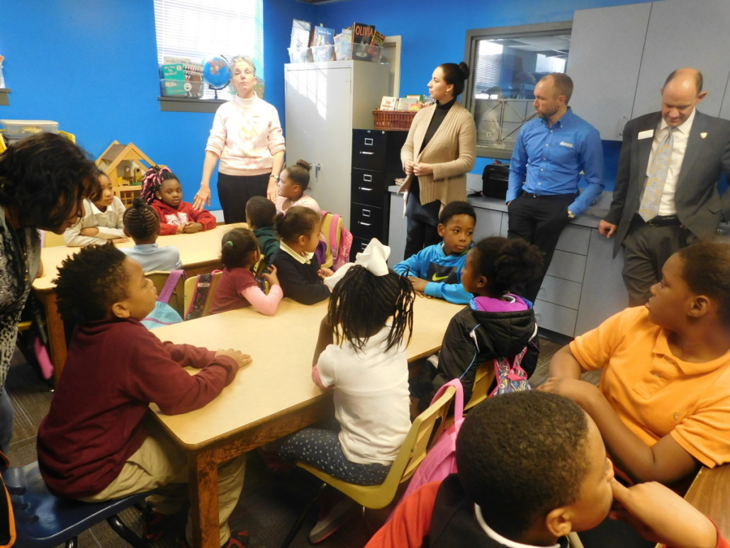 Representatives from Action Ministries and Aaron's present newly renovated technology center to young students by Carolyn Smith