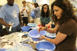 Students repack medical supplies for distribution by Medshare to hospitals overseas. Credit: Heather Dash Conley