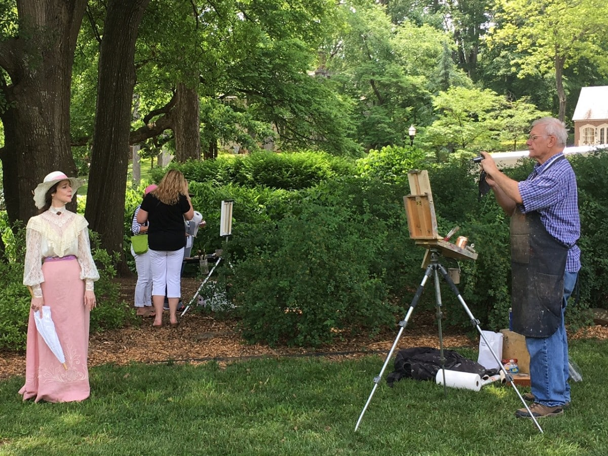 An artist and model at the Olmsted Plein Air Invitational Saturday April 30