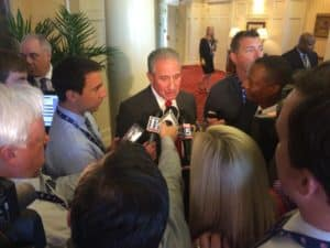 Arthur Blank interviewed in Charlotte by multiple reporters after winning the 2019 Super Bowl (Photo by Maria Saporta)