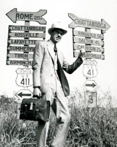 A hitchhiker stands between road signs for U.S. highways 411 and 41, circa 1945. Courtesy of Edwin L. Jackson