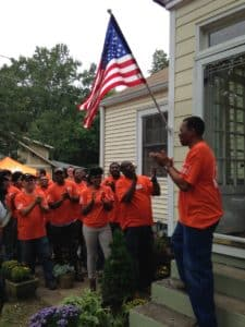 Volunteers from local Home Depot stores wrap up renovations at the home of a metro Atlanta veteran (Photo credit: The Home Depot Foundation)