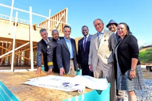 The Atlanta Police Foundation is leading an effort to built up to 25 homes by 202 near the Falcons stadium and sell them to police officers. The group attending a site visit included APF President and CEO Dave Wilkinson (left), Atlanta Police Chief George Turner, PulteGroup Executive Chairman Richard Dugas, Atlanta Mayor Kasim Reed, Falcons owner Arthur Blank, Atlanta Councilmember Ivory Lee Young Jr., and Atlanta Housing Authority President and CEO Joy Fitzgerald. Credit: APF