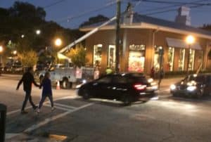The black vehicle is about to get blue-lighted by an Atlanta police cruiser on Tuesday evening, seconds after driving through a cross walk on Irwin Street in front of two pedestrians walking toward Krog Street Market. Credit: David Pendered