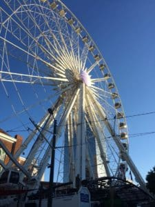 The 101 Marietta office tower overlooks SkyView Ferris wheel, which has proved to be such an attraction that the owner has signed a 20-year lease on the property adjacent to Centennial Olympic Park. Credit: David Pendered