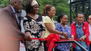 Lithonia Mayor Deborah Jackson (second from left) and civic leaders cut the ribbon on the city's farmers market in June 2016. Credit: