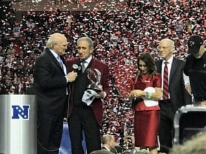 Arthur Blank accepts trophy as Angie Blank, Rich McKay and others watch (Photo by Maia nn