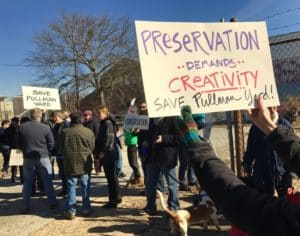 A crowd of about 50 individuals attended a rally Tuesday to urge the state to require any buyer of Pullman Yard to preserve buildings and Hardee Creek. Credit: Kelly Jordan