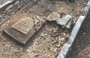 This close-up photo of the grave site of Dr. Beatrice Thompson shows the damaged stones and general lack of upkeep. The site has has since been restored by Historic Oakland Foundation. Credit: Historic Oakland Foundation
